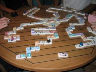 Dominoes;  The Game of Champions ~ So many dots, so little time.