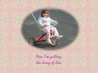 First Success ~ When Emma got her tricycle, early April, it took her several days to get the hang of using her feet to pedal.  This was her first success and she was delighted, as was I.  *Smile*