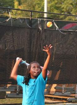 Nailah Ramos ~ ROBIN BATEMAN/SPECIAL TO THE TELEGRAPH   Nailah Ramos practices her serve as she prepares for her first competitive tennis event, which is being held this weekend at the John Drew Smith Tennis Center.