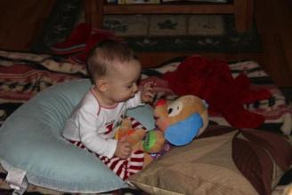 Aedan on Christmas Morning ~ Playing with the puppy we gave him. It's one of his fave gifts.