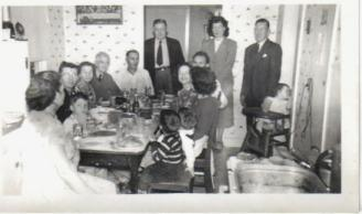 Christmas at Grandma's House 1948 ~ That's me in the highchair next to the electrical plugs!!