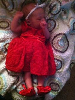 11-28-2012 ~  Trying on her Christmas dress for Santa. We tried to find tights, but I couldn't find any for preemies. *Heart*