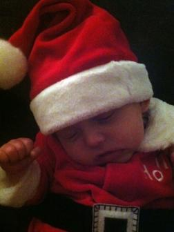 11-28-2012 ~  Rosalie practicing to be Santa. She feel promptly asleep, of course!