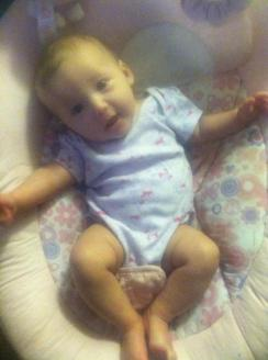 02-01-2013 ~  Rosalie talking with her Mommy. She's getting so long! Almost too long for Ye Faithful Bouncer...