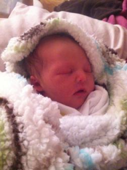10-24-2012 ~  Best birthday prezzie for Mommy, ever! Bundled up in her first blanket, all cozy and warm.