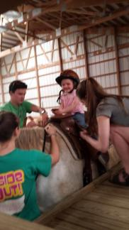So Excited! ~  Only four, and she wasn't one bit scared to get on that huge horse! Lol