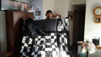 King Size Raiders Quilt for Alex ~  The quilt that started it all. He wanted a Raider's quilt and he is tall. The quilt kept growing. It is folded over in the picture.