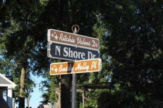 Corner Street Sign ~ A Street sign near the Surf Ballroom, with the streets renamed for Buddy Holly and Richie Valens