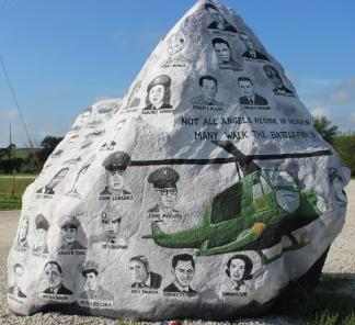"""Freedom Rock, September 2018 ~  The Freedom Rock (established in 1999) is a large (approx. 60+ ton) boulder located in rural Iowa that is repainted every year with a different Thank You for our nations Veterans to honor their service to our country.  The artist, Ray """"Bubba"""" Sorensen II, was inspired by the movie Saving Private Ryan, as well as, wanting to give Veterans a unique recognition on Memorial Day.   Sorensen paints The Freedom Rock on his own with the tremendous support of family and friends.  Sorensen is not commissioned to paint the rock but is able to do so each year with the generous help of donations.   While painting murals across th..."""