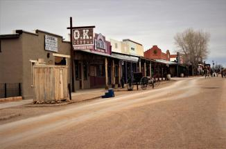 Tombstone ~ Though there is a state highway one block to the left in this photo, you'd never know it if you hadn't driven on it to get here.  Most of the 'downtown' area of Tombstone is segmented off, cars are not allowed on the dirt roads.  The OK Corral is just to the left in this photo, less than 100 yards away.  The 'Outhouse' in the photo is actually a ticket office for the Butterfield Stage Lines Ticket Office...