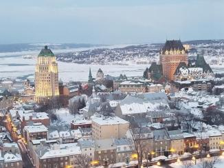 Old Quebec City ~ A view from my hotel room.  You can see the St. Lawrence Seaway.  Straight ahead is the L'Le D'Orleans, and island in the middle of the seaway.  The south leg of the seaway is visible.  The Notre-Dame de Québec Basilica-Cathedral is the small dome in the middle of the photo, with the Fairmont Le Château Frontenac Hotel to the right, and the Caisse-Depot & Placement to the left.  (I think I have those buildings labeled correctly.)