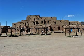 Taos Pueblo ~  Taos Pueblo (or Pueblo de Taos) is an ancient pueblo belonging to a Taos-speaking (Tiwa) Native American tribe of Puebloan people. It lies about 1 mile (1.6 km) north of the modern city of Taos, New Mexico. The pueblos are considered to be one of the oldest continuously inhabited communities in the United States.  This has been designated a UNESCO World Heritage Site.
