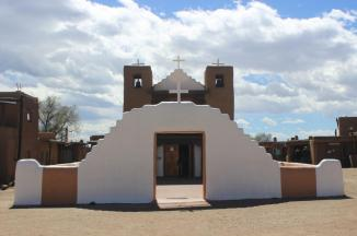 San Geronimo (St. Jerome) Church, Taos Pueblo ~  The present San Geronimo, or St. Jerome, Chapel was completed in 1850 to replace the original church which was destroyed in the War with Mexico by the U.S. Army in 1847. That church, the ruins still evident on the west side of the village, was first built in 1619. It was then destroyed in the Spanish Revolt of 1680 but soon rebuilt on the same site. St. Jerome is the patron saint of Taos Pueblo.