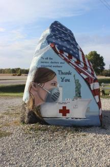 Freedom Rock ~ The Freedom Rock (also known as the Patriotic Rock) is a 12-foot-tall (3.7 m) boulder located along Iowa Highway 25 near Menlo in western Iowa approximately one mile (1.6 km) south of exit 86 on Interstate 80. The boulder weighs approximately 56 short tons (51 t; 50 long tons).