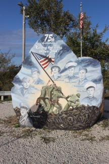 Freedom Rock - Another View ~ The Freedom Rock (also known as the Patriotic Rock) is a 12-foot-tall (3.7 m) boulder located along Iowa Highway 25 near Menlo in western Iowa approximately one mile (1.6 km) south of exit 86 on Interstate 80. The boulder weighs approximately 56 short tons (51 t; 50 long tons).