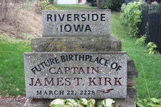 Future Birthplace of Captain James T. Kirk ~ A place of great reverence for Trekkies everywhere, a hero's future birthplace.   JUST BEHIND A SMALL YELLOW house, now used as a salon, in a private courtyard, we can admire the future birthplace of James Tiberius Kirk, captain of the Star Trek series' Enterprise spaceship.  A stone tells us that the Federation of Planets hero will be born there in 2228 (although some online sites claim his DOB is 2238). In the meantime, packs of Trek lovers and various nerds meet there at the annual Trek Fest in the Iowa countryside. On those days you can meet people dressed in space uniform alongside with the 1800-styled ...