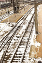 Desolate snow-covered tracks at a train station in the 1940's.