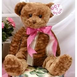 Picture of a cute Teddy Bear on a chair.