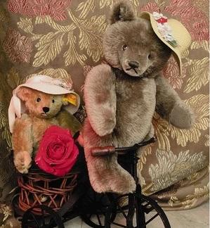 Cute Teddy Bears on a bike.
