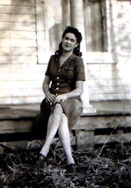 Photo of Mom on porch. Most likely in South Dakota.