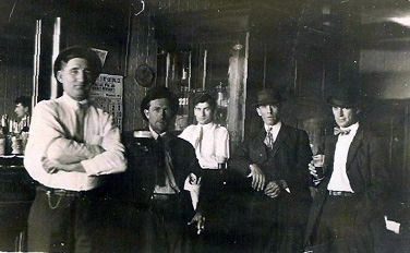 Grandpa and some of his um 'associates' from around 1920 in an Iron Mountain, MI tavern.
