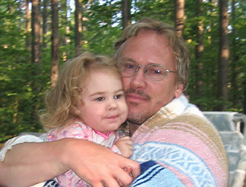 Photo of my daughter and me on our first family camping trip.