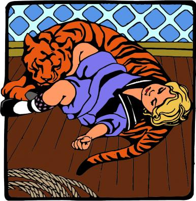 A young girl curled up with a sleeping tiger
