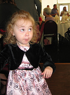 Maddie dressed up for a wedding reception captured attention with looks like this one.