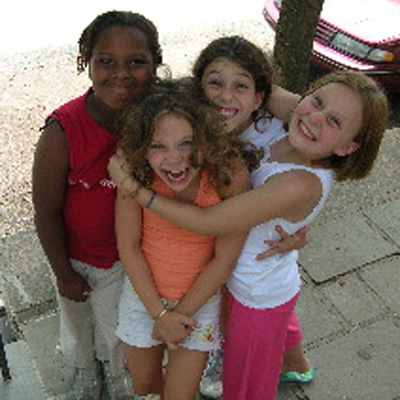 Raven, age 10, is hugging her 3 best friends at art camp last summer !