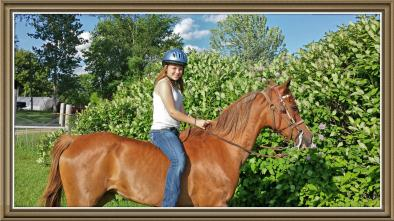 Leah loved riding her horse around the farm.
