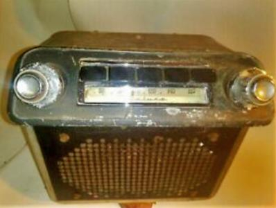 A 1950's vintage car radio unit.